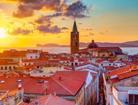 bilete de avion Alghero; A sunset over Alghero city, Sardinia