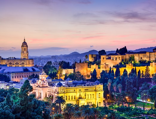 Bilete de avion Malaga; Malaga, Spain cityscape at the Cathedral, City Hall and Alcazaba citadel of Malaga.