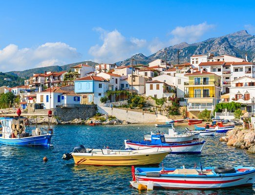 Colorful fishing boats in Kokkari port, Samos island, Greece