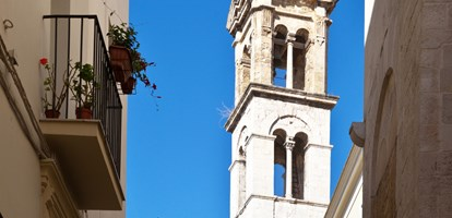 Italy. The narrow streets of the old town of Bari. The bell tower of the church of St. Giacomo