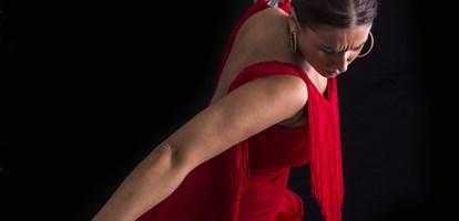 Flamenco dancer dressed in red