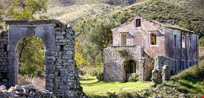 Old Perithia, Corfu's oldest village, incredible ruins of stone build houses, close to Mount Pantokrator, abandoned village of Sinies. Greece.