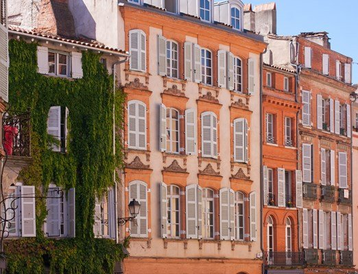 View on facades on a square of Toulouse, France